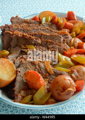 Roasted beef with vegetables and potatoes - Stock Photo