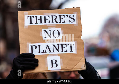 A closeup view of a homemade cardboard sign saying there's no planet b held by an eco activist during a city rally. Campaigners march against climate change. - Stock Photo