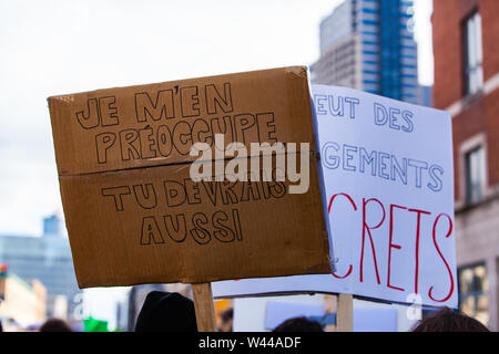 A French sign reads I do care, you should too as environmentalists march against climate change in Montreal, Canada. - Stock Photo