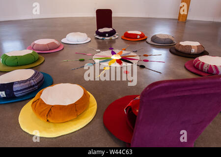 A close up view on colorful cushions forming a sacred circle, religious ritual originating from Native American tribes, 12 colors are worshiped for prosperity.