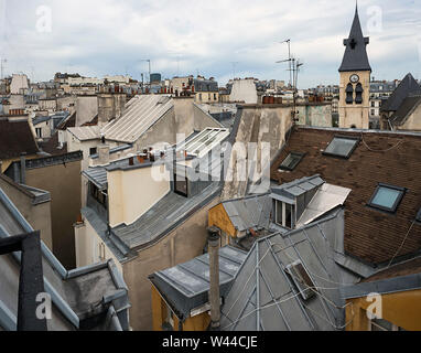 View from a 6th floor apartment in the 6th arrondisement of Paris show a variety of colors, textures, shapes, colors and angles - Stock Photo