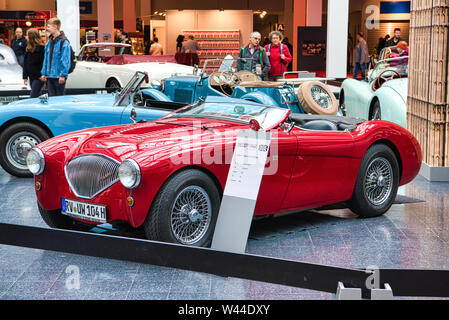FRIEDRICHSHAFEN - MAY 2019: red AUSTIN-HEALEY 100 BN1 cabrio roadster 1955 at Motorworld Classics Bodensee on May 11, 2019 in Friedrichshafen, Germany - Stock Photo