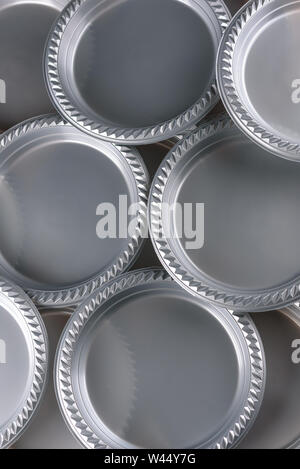 A group of disposable plastic dinner plates for wedding, party, birthday, catering. - Stock Photo