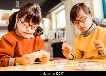 Diligent short-haired girls with mental problems being involved - Stock Photo