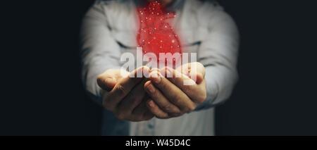 Human hand holding neon red heart innovative technologies. Mixed media. - Stock Photo