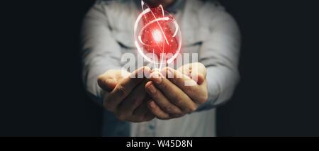 Human hand holding neon red heart and atom innovative technologies. Mixed media. - Stock Photo