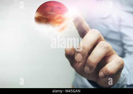 Human touching New Home Mars on a beautiful white background. Mixed media. - Stock Photo