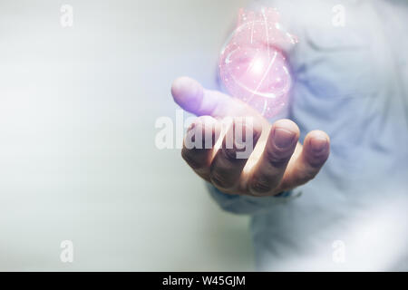 Human forefinger touches red heart innovative technologies on a white background. Mixed media. - Stock Photo