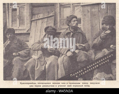The Red Army soldiers, who were under German imprisonment for less than an hour, had already received their first allowance and satisfied their terrible hunger. The truth about prisoners of war in German captivity. Photo from the newspaper of the 1940s. - Stock Photo