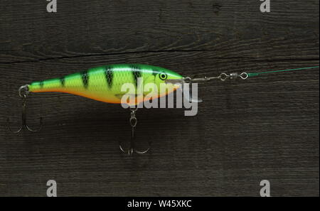 crankbait lure fishing tackle for catching of predatory fish close to - Stock Photo