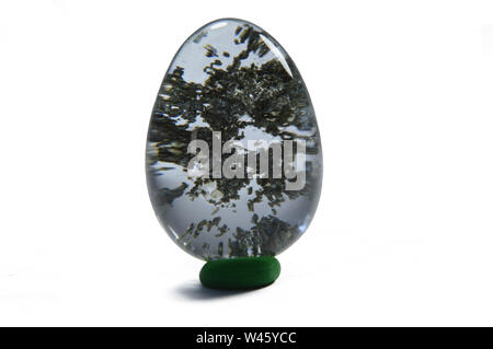 Quartz with chlorite inclusion isolated on white background, locality Pakistan. - Stock Photo