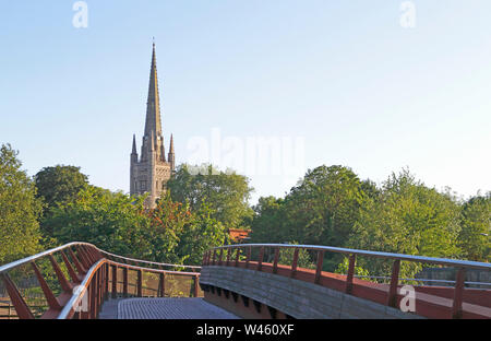 The Norman tower and 15th century spire of Norwich Cathedral viewed from the Jarrold Bridge in Norwich, Norfolk, England, United Kingdom, Europe. - Stock Photo