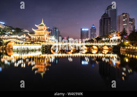 Guiyang, China - February 9 2019: Twilight over the famous Jiaxu tower in the heart of Guiyang downtown district in Guizhou province in China. - Stock Photo