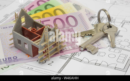 architectural blueprint plan with house key - Stock Photo