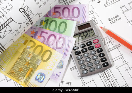 architectural blueprint plan with financial calculator - Stock Photo