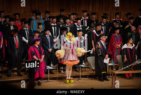London, UK. 19th July 2019. Grayson Perry as Chancellor of the University of the Arts London ( UAL ) at degree awards ceremony at the Royal Festival Hall-19 July 2019 The artist Grayson Perry CBE, RA,  as Chancellor of UAL with robbed colleagues from UAL Turner Prize-winning artist and UAL Chancellor Grayson Perry has debuted his new 2019 Chancellor robes specially designed for him by London College of Fashion MA Costume Design for Performance student, Rachele Terrinoni. Credit: BRIAN HARRIS/Alamy Live News - Stock Photo