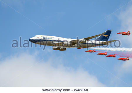 Royal International Air Tattoo Flypast, with the Royal Air Force Red Arrows and British Airways 747 callsign 'BA100' - Stock Photo
