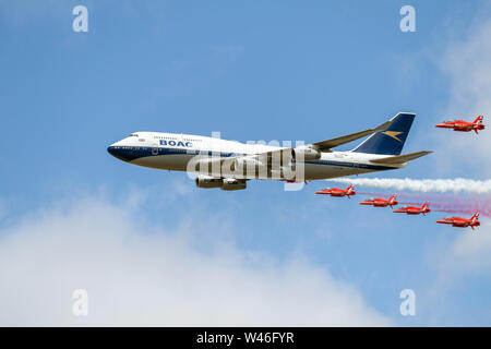 RAF Fairford, Gloucestershire, UK. 20th July 2019. Royal International Air Tattoo Flypast, with the Royal Air Force Red Arrows and British Airways 747 callsign 'BA100' Credit: Bob Sharples/Alamy Live News - Stock Photo