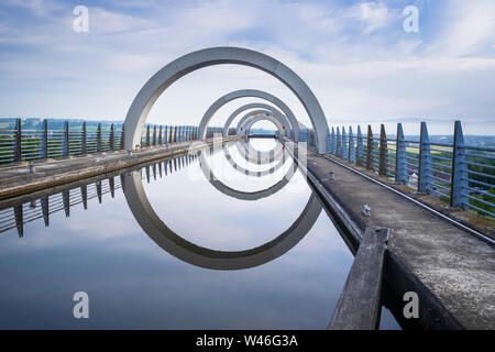 The Falkirk Wheel in Scotland is a rotating canal boat lift a form of high rise lock connecting the Forth and Clyde Canal with the Union Canal. - Stock Photo