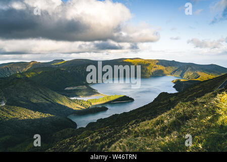 Beautiful panoramic view of Lagoa do Fogo, Lake of Fire, in Sao Miguel Island, Azores, Portugal. Sunny day with blue sky and clouds. - Stock Photo