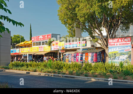 shops on Riva; seaside promenade; business; vendors, colorful, signs, golden hour, Dalmatia; Split; Croatia; Europe; summer, horizontal - Stock Photo
