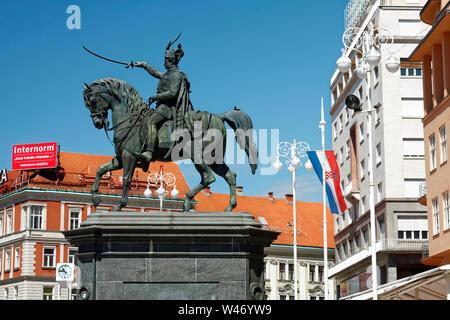 equestrian statue; Josip Jelacic; 1866; Trg Bana Jelacica; Jelacic Square; advertising sign, Zagreb; Croatia; Europe; summer, horizontal - Stock Photo