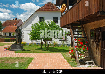 Josip Broz Tito's birthplace village; Tito statue beside his house, other old buildings, historic, Ethnological Museum Staro selo; Kumrovec; Croatia; - Stock Photo