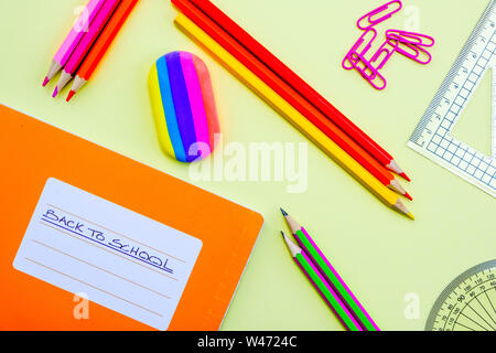 Back To School Note Book and Pencils With Paper Clips A Rubber and Geometry Set - Stock Photo