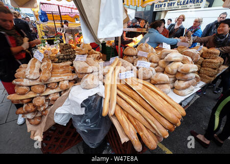 Stall selling various types of breads at the Saturday market in Portobello Road, London - Stock Photo