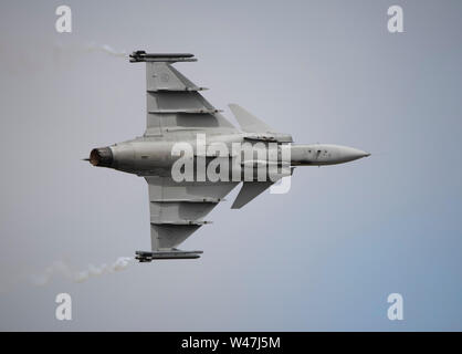RAF Fairford, Glos, UK. 20th July 2019. Day 2 of The Royal International Air Tattoo (RIAT) with military aircraft from around the world assembling for the world's greatest airshow with a full flying display in good weather. Image: Saab JAS 39C Gripen flying display from the Swedish Air Force. Credit: Malcolm Park/Alamy Live News. - Stock Photo