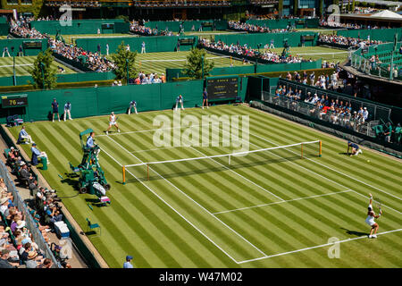 Caty McNally and Heather Watson on court 12 with a General View of The Wimbledon Championships 2019. Held at The All England Lawn Tennis Club, Wimbled - Stock Photo