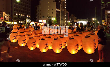 Akita Kanto Matsuri festival. a Japanese festival celebrated from 3–7 August, hope for good harvest. A long bamboo poles bearing lanterns are carried - Stock Photo