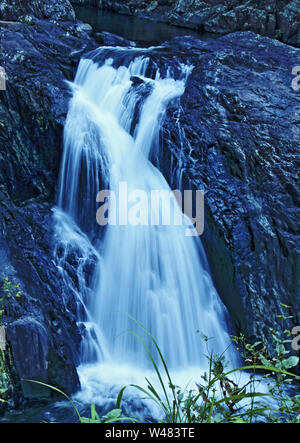 Crystal Cascades waterfall captured in LE on Freshwater Creek on Lamb Range in back of Redlynch Valley, Cairns, Far North Queensland, Australia