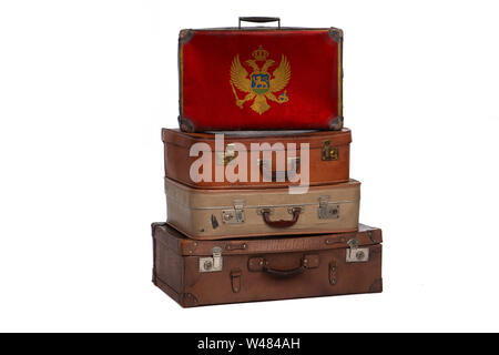 Montenegro, Montenegrin travel concept. Group of vintage suitcases isolated on white background - Stock Photo