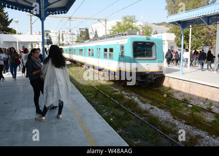 Tunisian commuters at the Sidi Bou Said metro stop in Tunis await the arrival of a subway train, in Tunisia. - Stock Photo