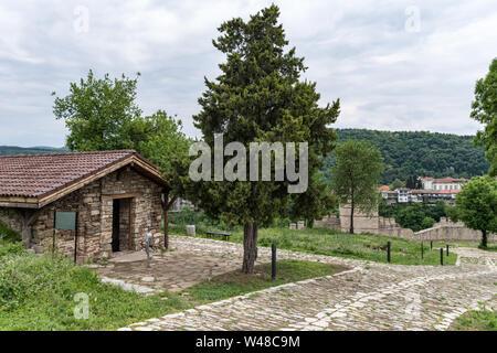 Church and part of wall  of Trapezitsa fortress. Veliko Tarnovo in Bulgaria. - Stock Photo