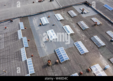 large factory roof. warehouse building in an industrial estate. birds eye view - Stock Photo