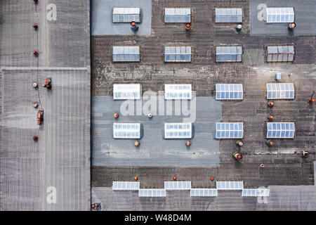 roof of an industrial building with skylights and ventilation. aerial top view - Stock Photo