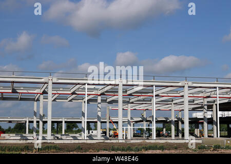 factory construction site with workers - Stock Photo