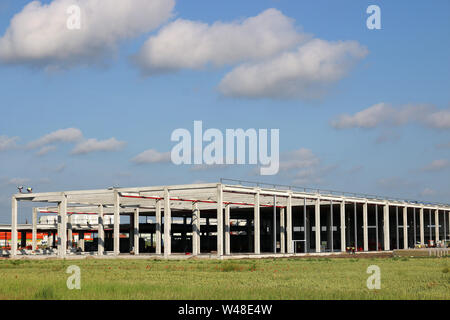 New factory construction site with workers industry - Stock Photo
