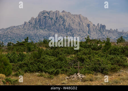 the Mountain Tulove Grede in Croatia with a grave - Stock Photo