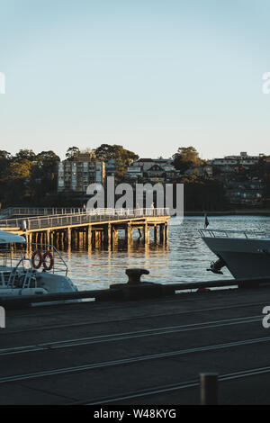 Pyrmont, New South Wales - JULY 18th, 2019: Early morning sun lights Darling Island at Pirrama Park/Jones Bay Wharf, Sydney NSW. - Stock Photo