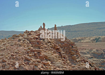The desert landscape around the lost city of Petra in Jordan - Stock Photo