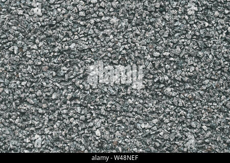 Grey stone background. Abstract pattern of gravel. Natural road texture. Rock material. Grunge floor on street.