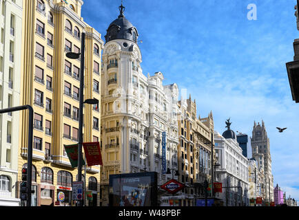 Looking along the Gran Via, in the heart of Madrid's shopping  district,  towards the Telefonica building,  from Callao metro station.  Madrid, Spain - Stock Photo