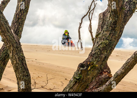 Relaxation on the dunes in National Unesco Park - Leba, Poland. - Stock Photo