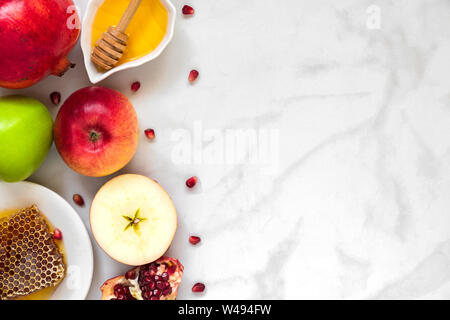 Jewish holiday Rosh Hashana background with honey, pomegranate and apples. flat lay. top view with copy space - Stock Photo