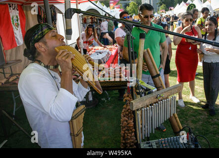 Surrey, Canada. 20th July, 2019. A musician performs Latin American music during the Fusion Festival held at Holland Park in Surrey, Canada, July 20, 2019. The Fusion Festival is an annual celebration of multiculturalism in Canada. Featuring food, music, artifacts, dancing and other performances, the two-day event attracted over 10 thousand people this year. Credit: Liang Sen/Xinhua/Alamy Live News - Stock Photo