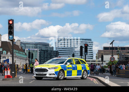 20th July 2019 - London, UK. Brand new Police Ford Mondeo vehicle blocking traffic on Westminster Bridge due to Anti Brexit protest. - Stock Photo