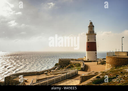 Lighthouse on wharf overlooking lake in daytime - Stock Photo